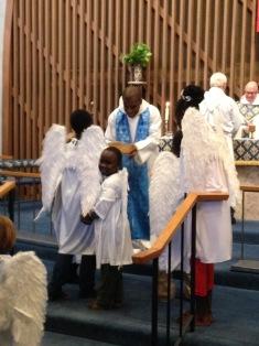 Sunday school children bring the offering in Advent